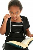 pic of girl reading book  - Young Africam American girl with glasses reading a book - JPG