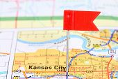 stock photo of kansas  - Kansas City Missouri. Red flag pin on an old map showing travel destination. ** Note: Shallow depth of field - JPG