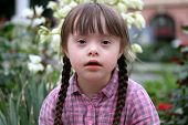 stock photo of playgroup  - Portrait of beautiful young girl in the park - JPG