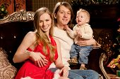 pic of new years baby  - Happy smiling family near the Christmas tree celebrate New Year - JPG