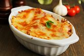 stock photo of lasagna  - Fresh lasagna in a white container with basil - JPG