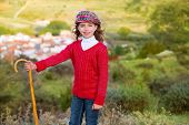 pic of shepherdess  - Kid girl shepherdess smiling with wooden baston in Spain village - JPG