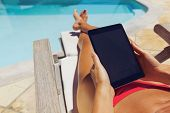 pic of pov  - Relaxed woman reading on digital tablet - JPG