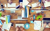 stock photo of communication people  - Group of Business People Working on an Office Desk - JPG