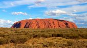 stock photo of rocking  - Uluru also known as Ayers Rock is one of Australia - JPG