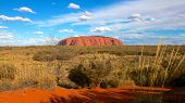 stock photo of aborigines  - Uluru also known as Ayers Rock is one of Australia - JPG