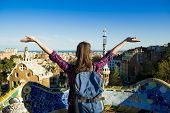 image of gaudi barcelona  - Rear view of young female tourist enjoying the view in Parc Guell in Barcelona - JPG