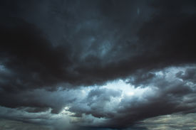 picture of hurricane wind  - Stormy clouds gray low key sky with dramatic shadows and lights - JPG