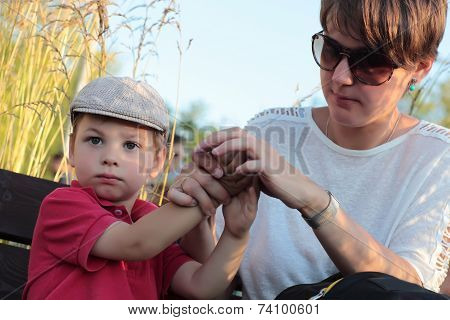 Mother Cleans Hands Her Son Hands
