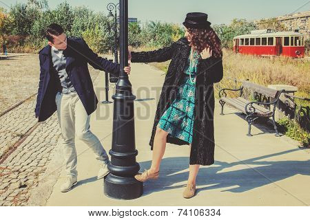 Romantic Couple In Love In Fashion Style  On Rail Road