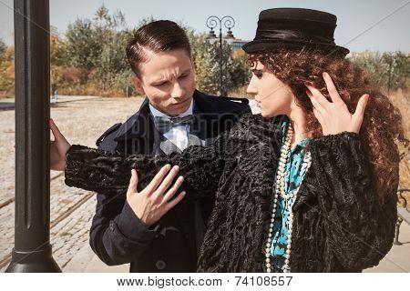 Young Fashionable Couple Alongside A Railway Line Beside Street Pole