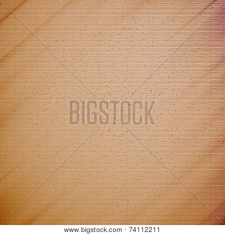 Abstract cardboard texture background with natural fiber parts.