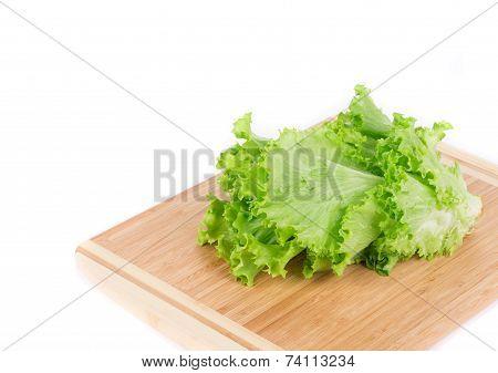 Fresh lettuce on wooden platter.