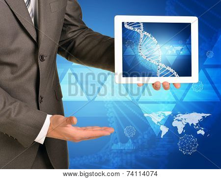Man hands using tablet pc. Image of DNA helix on screen