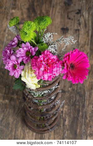 Bouquet Of Flowers In Metal Spring On Grunge Wood Surface Artistic Conversion