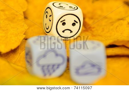 Depressing And Sad Weather Of Autumn Shown On Dice