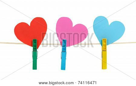 Three Paper Hearts On Clothespins On A Rope