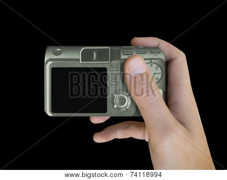 LCD of compact camera in hand (isolated, black background)