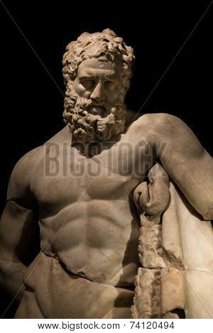 A Statue Of Powerful Hercules, Closeup, Isolated In Black