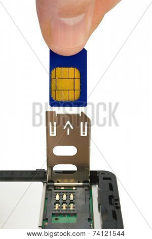 Hand install sim card to mobile phone, close-up, isolated on white background