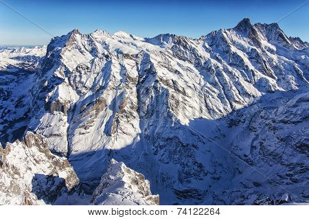 Jungfrau Mountain Wall In Winter Helicopter View