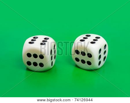 Two gambling dices ( only six ) on green background