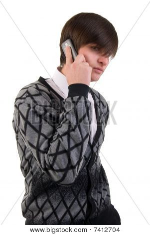 Portrait Of Modern Young Man Talking On Mobile Phone. Studio Shoot Over White Background.