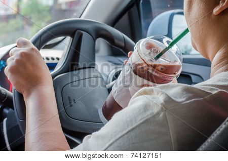Vehicle Concept - Man Drinking Coffee While Driving The Car