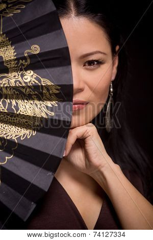 Portrait of asian woman with hand fan