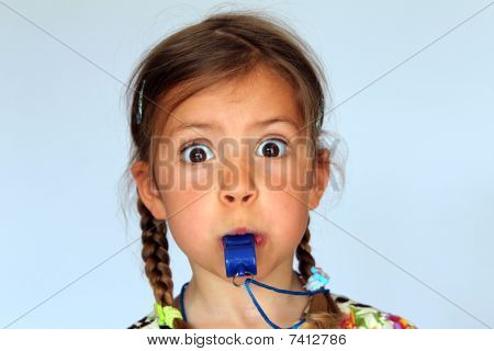 Girl blowing whistle