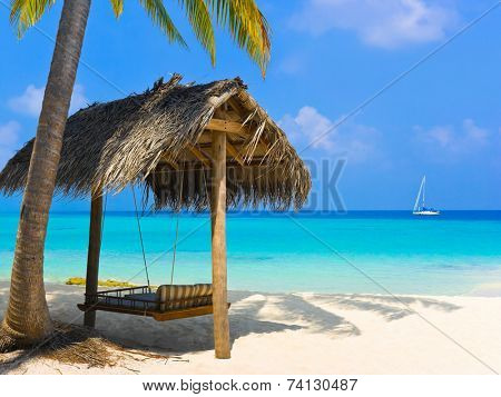 Swing on a tropical beach - vacation background