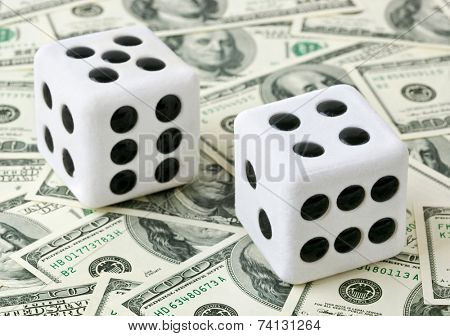 Two dices on money background - business concept