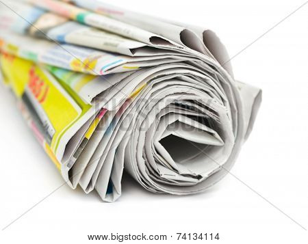 Roll of newspapers isolated on white background