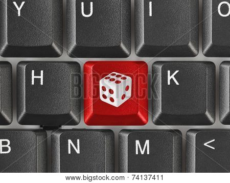Computer keyboard with dice key - technology background