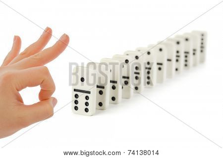 Hand and domino isolated on white background