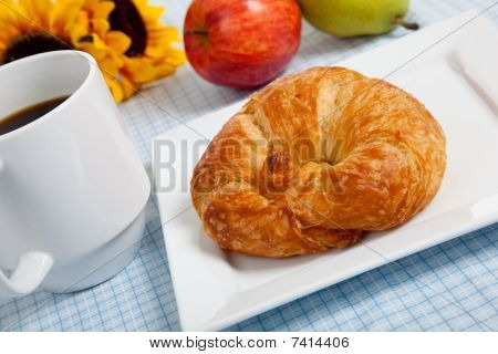Croissant With Apples And Coffee On A Gingham Tablecloth