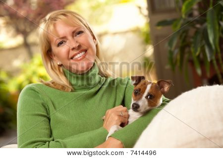 Woman And Puppy Enjoying Their Day On The Sofa