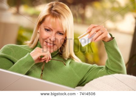 Beautiful Woman With Credit Card Using Laptop