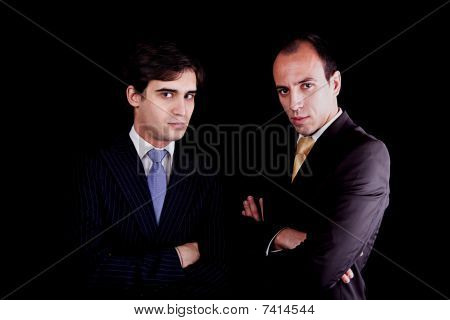 Two Young Businessmen With A Serious Look