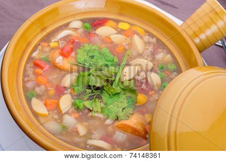 A Ceramic Bowl On A Table With Chinese Soup