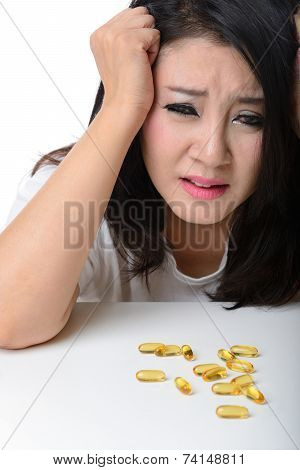 Close Up Portrait Of Asian Woman With Headache
