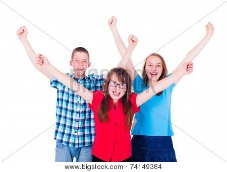 Group Of Happy Teenagers Raising Hands