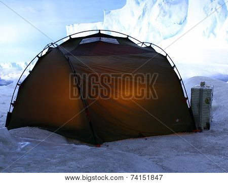 Tent In The Mountains With Snow And Ice