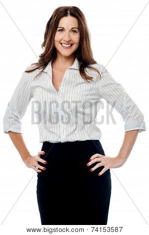 Smiling Businesswoman With Hands On Hips