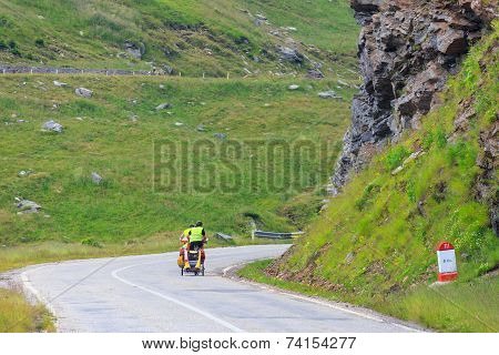Unidentified cuple of cyclists going to road in Fagaras Mountain Romania