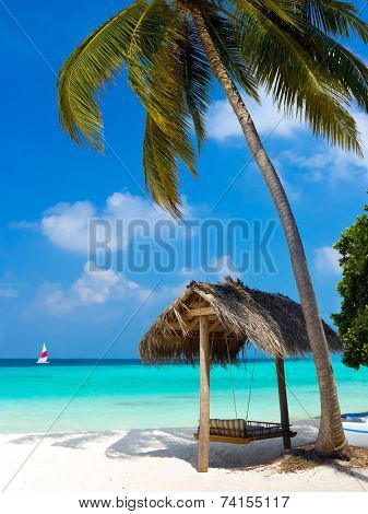 Swing on a tropical beach - vacation symbol