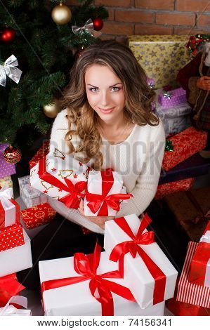 Beautiful woman with Christmas presents