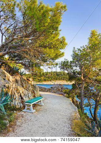 Pathway, bench and sea at Makarska, Croatia - vacations background