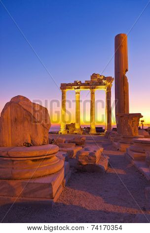 Old ruins in Side, Turkey at sunset - archeology background