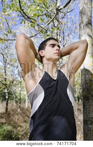 Runner Man Warming Arms Into The Trees